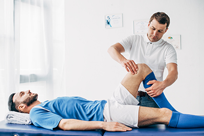 Physiotherapist massaging